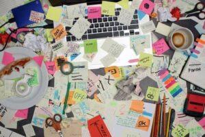 messy desk with sticky notes