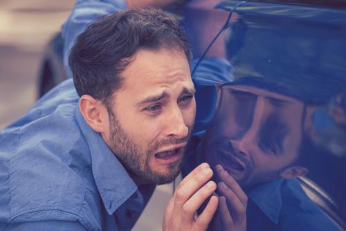 a man upset next to car, car decals